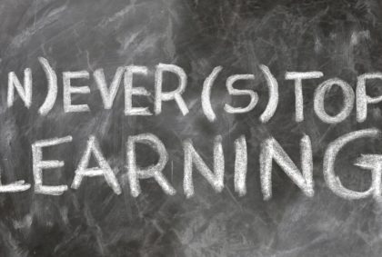 "a blackboard showing the text - ""never stop learning"""